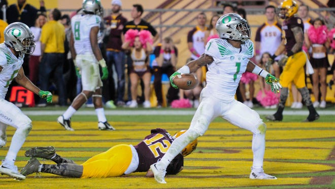 Oregon cornerback Arrion Springs celebrates after an interception for the win.