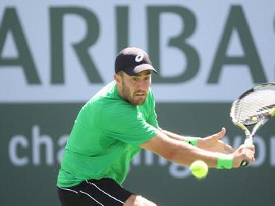 American Steve Johnson, a USC gaduate, plays at the BNP Paribas Open in 2013.