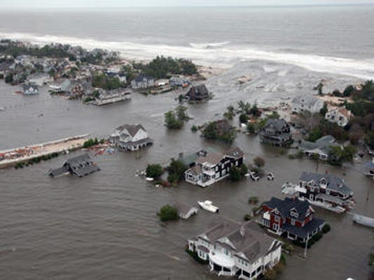 Flooding in Mantoloking following superstorm Sandy's storm surge (AP Photo/U.S. Air Force, Master Sgt. Mark C. Olsen)