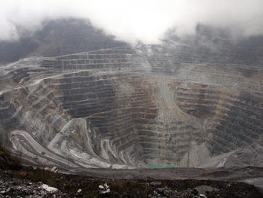 This photograph taken on August 16, 2013 shows a general view of the Freeport McMoRan's Grasberg mining complex, one of the world's biggest gold and copper mines located in Indonesia's remote eastern Papua province.