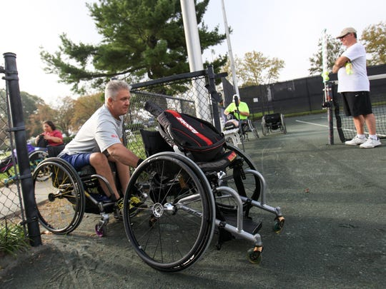 Michael Sullivan, of Philadelphia, Pa. makes his way onto court three for the men's singles B division of the 2015 USTA Middle States Wheelchair Tennis Championships at DuPont Country Club Saturday.