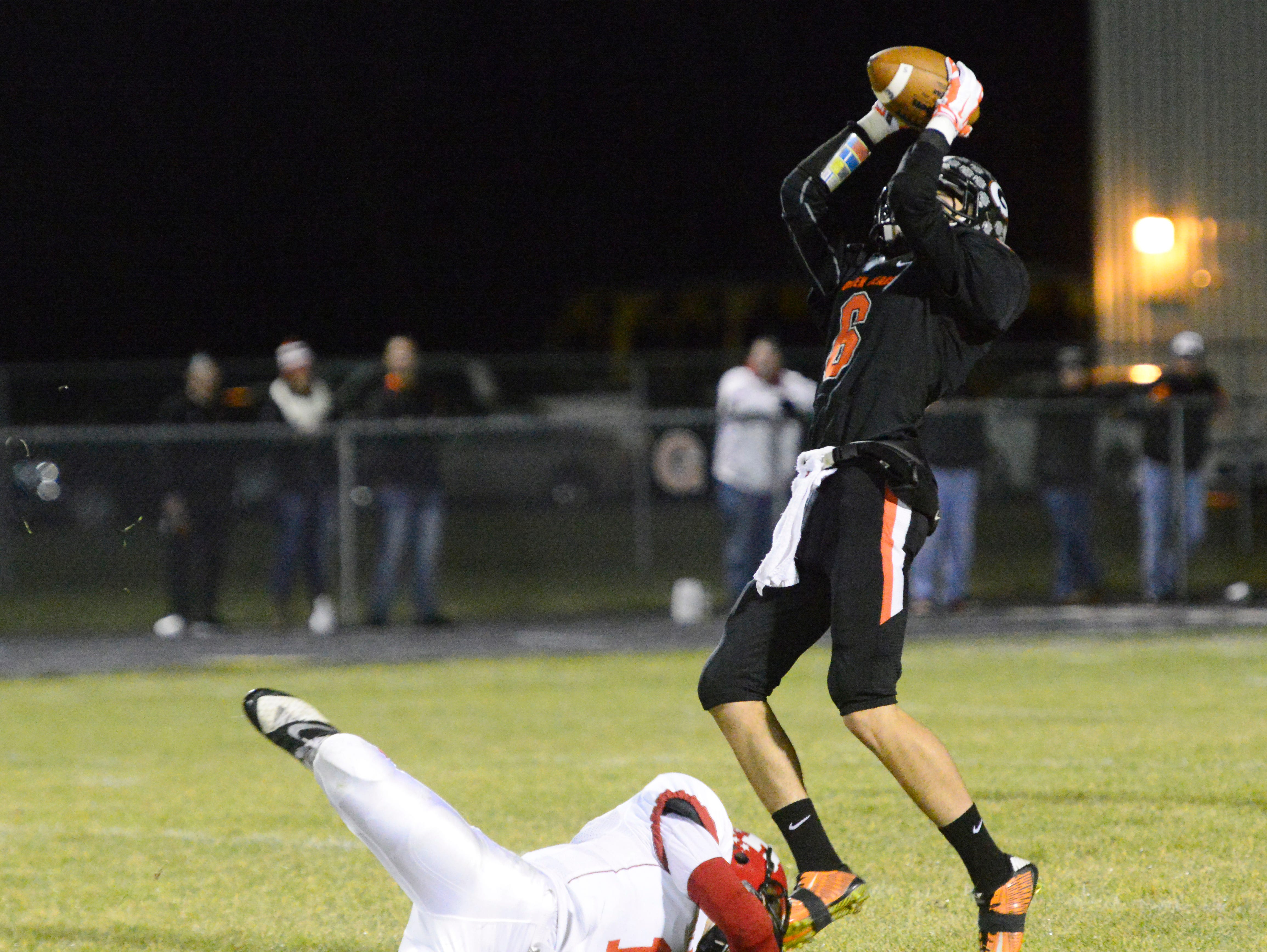 Gibsonburg's Marcus Tille makes the catch and scores a touchdown to make the score 34-12 on Friday night.