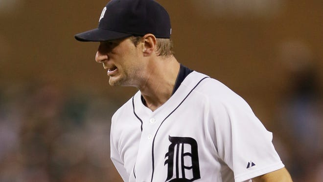 Detroit Tigers starting pitcher Max Scherzer reacts after striking out Kansas City Royals' Eric Hosmer to end the top of the fifth inning of a baseball game in Detroit, Tuesday, Sept. 9, 2014. (AP Photo/Carlos Osorio)