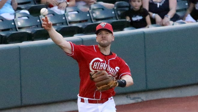 Chihuahuas third baseman Ryan Schimpf throws to first base after scooping up a ground ball recently.