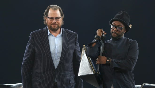 Salesforce.com Chairman and CEO Marc Benioff stands on stage with musician Will.i.am during a program at the Indiana Convention Center in 2014.