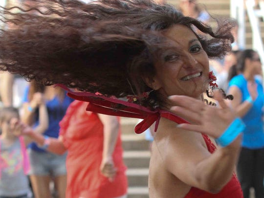 Anat Shamash dances to a live band during the 2014 St. Anthony's Italian, which launches Sunday, June 12.