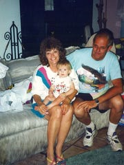 Sandi Martin, left, and Bob Martin, right, pose with their grandson in this undated family photo. Martin was killed by Ernesto Martinez on Aug 15, 1995.