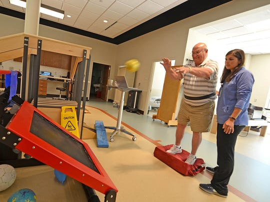 At Methodist Outpatient Therapy in Ridgeland, physical therapist Rachel Cooley works with state Rep. Gary Chism on therapeutic exercises designed to improve his endurance, strength, flexibility and balance.