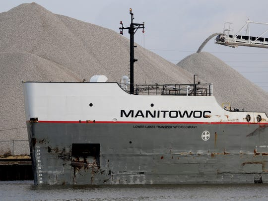 The lakes carrier Manitowoc unloads limestone at the Graymont Western Lime dock on May 9.