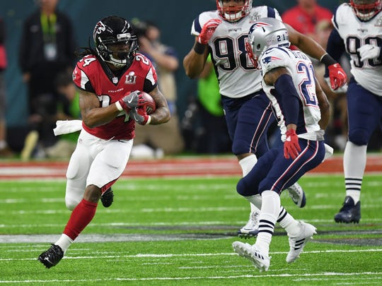 Atlanta Falcons running back Devonta Freeman runs the ball against the New England Patriots during Super Bowl LI.