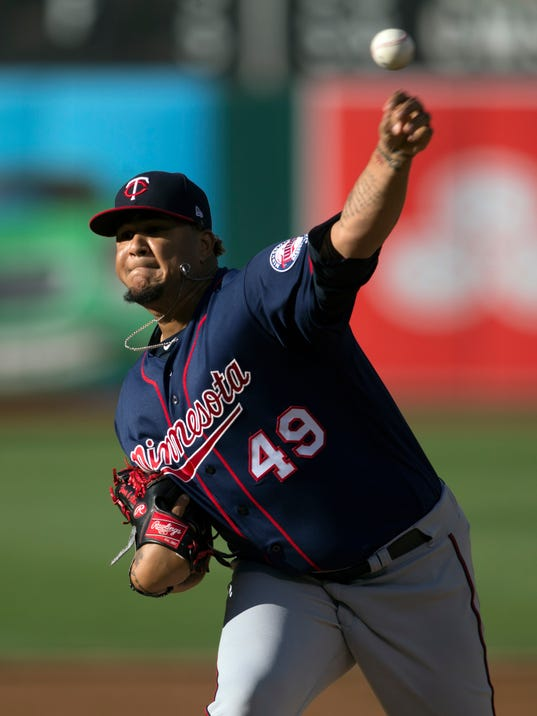 Minnesota Twins starting pitcher Adalbert Mejia delivers against the Oakland Athletics during the first inning of baseball game on Saturday, July 29, 2017, in Oakland, Calif. (AP Photo/D. Ross Cameron)