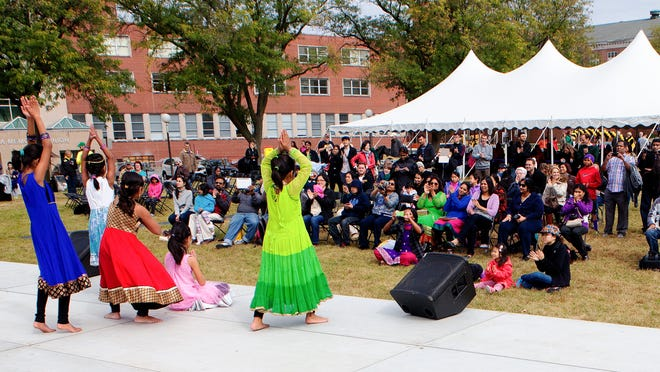 In this 2014 file photo, members of the Sampradaya Dance Troupe perform on stage at the Celebrating Cultural Diversity Festival at Hubbard Park on the University of Iowa campus.