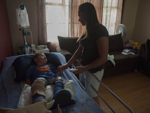 West Deptford resident Esther Jackson cares for her son Carsten Jackson, 4, who was suffered a severe brain injury after being hit by a car 2 years ago. Thursday, July 17, 2014.