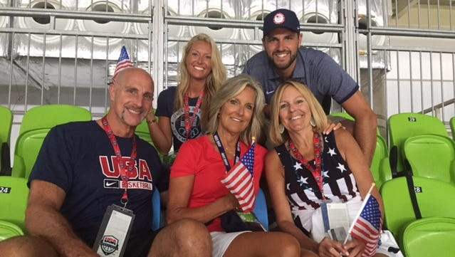 Elena Delle Donne's family consisting of her father Ernie, mother Joanie, aunt Jill Johnson (front), and sister-in-law Jennifer and brother Gene (back) cheer her on in Saturday's gold medal final.