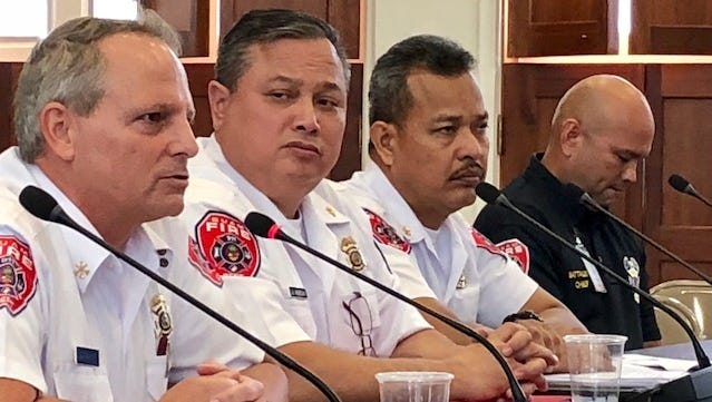 Acting Fire Chief Daren Burrier, left, on Tuesday testifies at the Guam Congress Building in support of a bill seeking to implement and raise fees and charges that the Guam Fire Department charges. GFD officials say the proposed changes in fees, most of which have not been implemented or changed since 2007, are necessary for cost-recovery and to make Guam compliance with the International Fire Code.