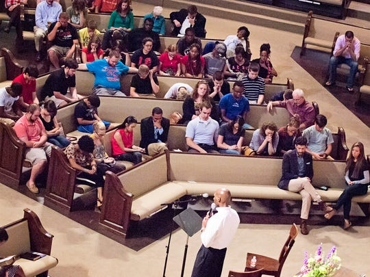 Several area churches came together at First Baptist Church for a discussion on 'Pursuing Diversity, Not Division' on Wednesday night. The evening began with prayer.