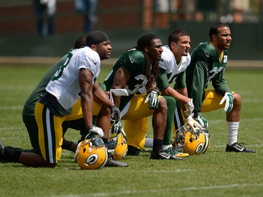 From left, Green Bay Packers' Randall Cobb, Tramon Williams, Myles White and Micah Hyde look on during training camp practice at Ray Nitschke Field.