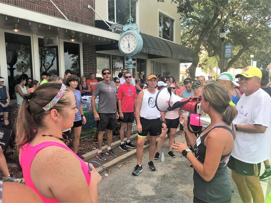 Erin Schuck of the Running Zone gives final instructions to participants in last week's fun run at Hell 'n Blazes Brewing Company in Melbourne.
