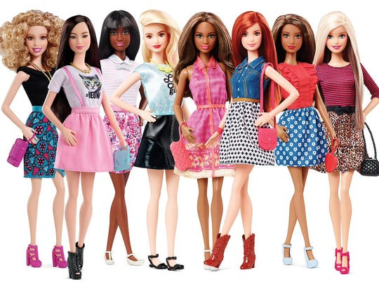 This photo provided by Mattel shows barbie dolls wearing high heel and flat shoes. A new line of Barbie dolls has the 56-year-old fashionista rocking flat shoes for the first time. Toymaker Mattel said flats are an effort to accessorize street styles Barbie wears in the new line. (Mattel via AP)
