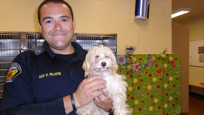 Officer Hector Palafax and Cassie.
