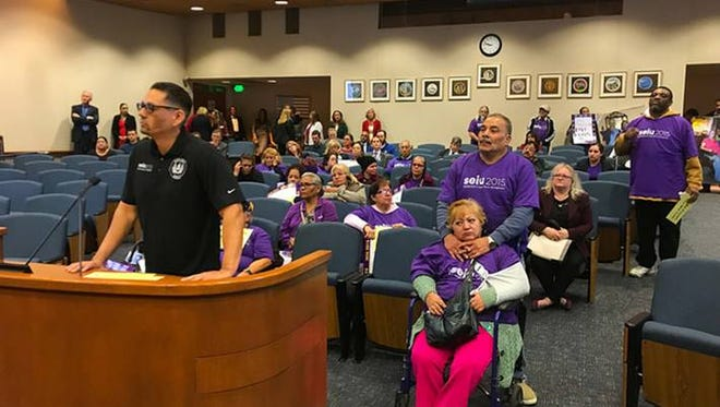 Miguel Benitez from SEIU speaks during a February meeting as caregivers appeal to the Ventura County Board of Supervisors for wage increases. The supervisors voted Tuesday to give caregivers a raise.