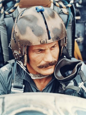 Brig. Gen. Robin Olds (a Col. at the time) seated in an F-4 with his iconic mustache.