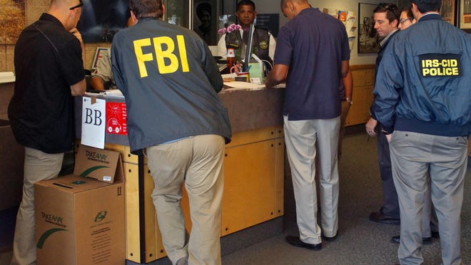 The Inland Empire Public Corruption Task Force made up of the FBI, District Attorney's Office and the IRS raid Palm Springs City Hall on Sept. 1, 2015.
