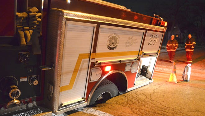 An Indianapolis fire engine fell into a sinkhole at Boyd and Finley avenues on its way to a small fire in an unoccupied home in the area, according to an Indianapolis Fire Department news release.