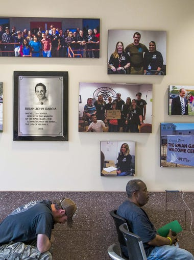 Photos honoring Brian Garcia hang in the lobby of the new Brian Garcia Welcome Center at the Human Services Campus in downtown Phoenix, on March 15 2017.