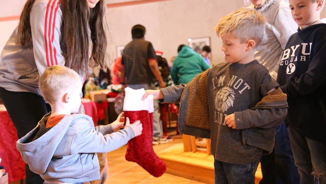 Children who attended the Christmas dinner event held at the Community Soup Kitchen With Grace received gifts that were donated by the community Friday, Dec. 25, 2015.