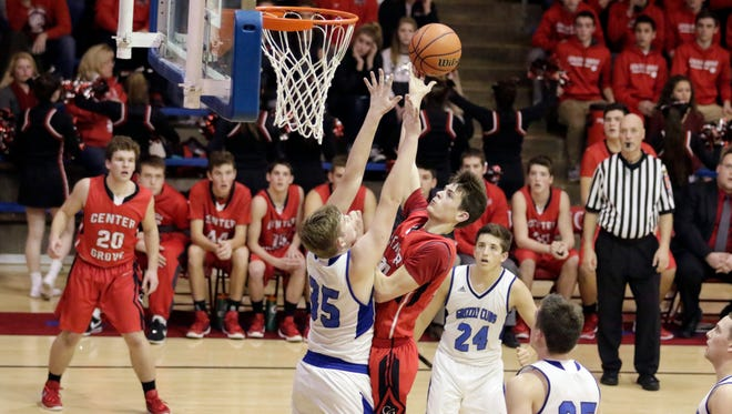 Center Grove Nate McLain (24) puts up a shot over Franklin Hunter Gross (35) during the 2nd half of the semi-final game of the Johnson County Tournament at Indian Creek.