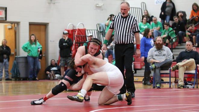 Paint Valley's Teagan McFadden wrestles Westfall's Scott Mulkey in the 182-pound championship final Saturday at Zane Trace High School.