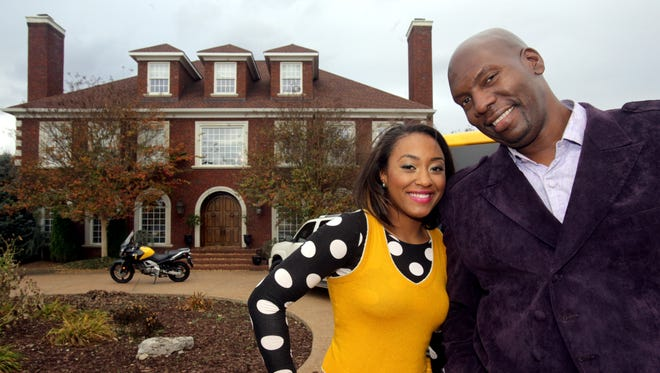 """Ben Tankard stands with his youngest daughter, Cyrene Tankard, in front of their Murfreesboro home. The family will debut the third season of """"Thicker Than Water,"""" set to air March 27."""
