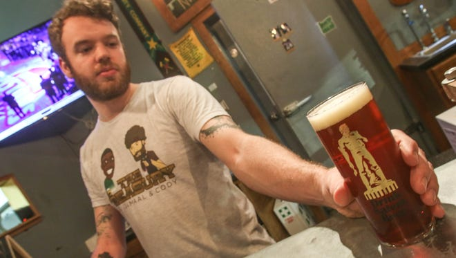 Cody Wingard serves a Redshift IRA in a special monthly artisan glass at Vagabond Brewing.