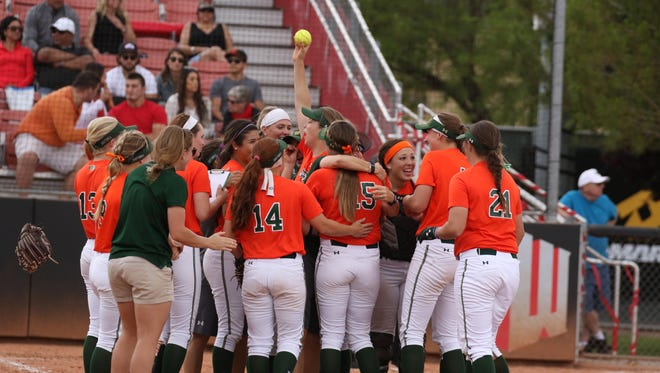 CSU senior Holly Reinke, seen holding the ball in the middle of the celebration, threw a no-hitter at UNLV on Sunday.