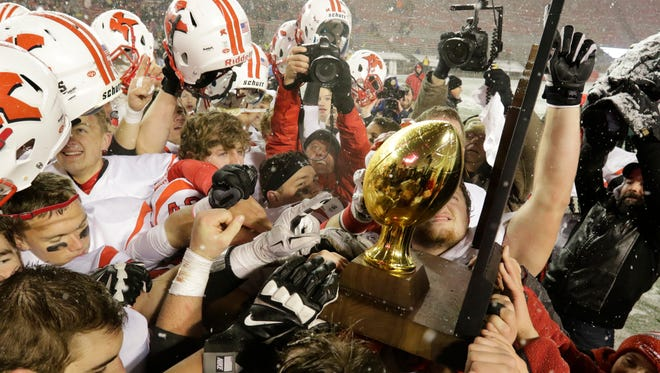 Members of the Kimberly football celebrate their victory over Arrowhead in last season's WIAA Division 1 state championship game at Camp Randall Stadium in Madison. The Papermakers will enter the 2016 season on a 42-game winning streak and seeking their fourth straight state title.