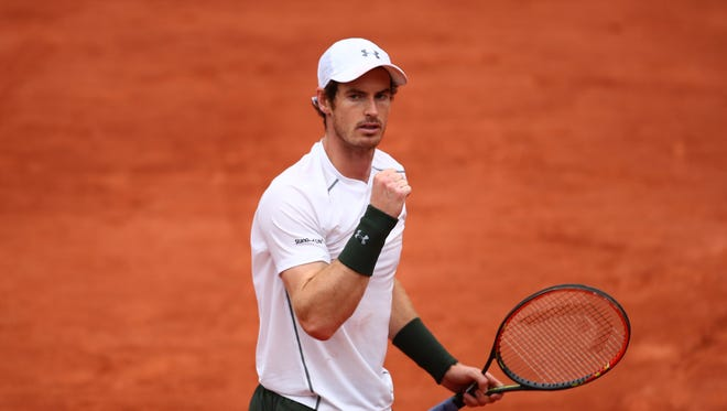 Andy Murray of Great Britain celebrates victory during his fourth round match against John Isner of the United States at the 2016 French Open on May 29.