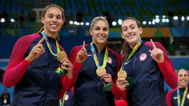Left to right: Gold medalists Brittney Griner, Elena Delle Donne and Breanna Stewart celebrate after defeating Spain in the final at the Rio Olympics.