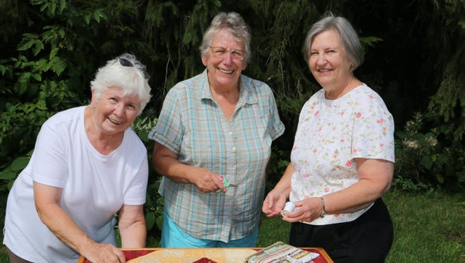 """Mountain Laurel Quilt Guild members, from left, Marjory Harris of Troy and Eleanor Fanslau and Peggi Yacovissi, both of Wellsboro, stitch a quilt on Yacovissi's small quilting frame. The public will have that same opportunity before each performance of """"Quilters."""""""