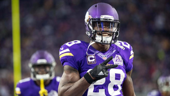 Minnesota Vikings running back Adrian Peterson (28) smiles prior to the game against the Green Bay Packers at U.S. Bank Stadium.