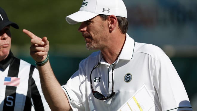 CSU coach Mike Bobo confers with referees while facing UTSA in the second half  Sept. 10, 2016 at Hughes Stadium. The Rams play at Boise State on Saturday night.