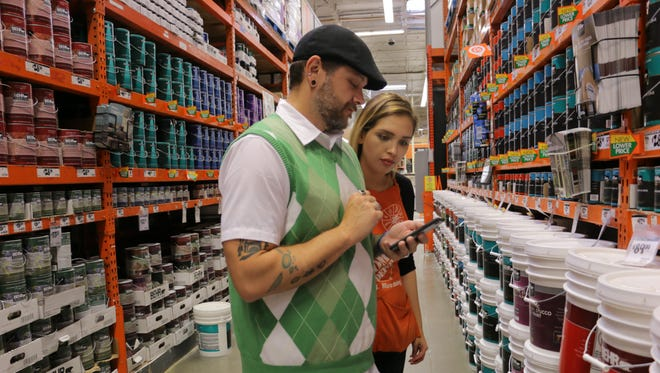 At a Home Depot store in Marina Del Rey, Calif, salesperson Brandi Flores uses Home Depot's smartphone app with a customer on Oct. 17, 2016.  Photo by Michael Kofsky, for USA TODAY  [Via MerlinFTP Drop]