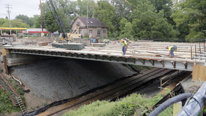 The opening of the bridge on Webster Avenue will be celebrated with a ribbon cutting at noon Saturday in Allouez.