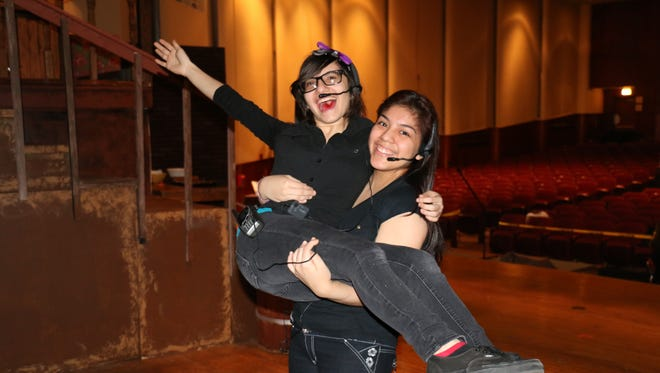 Performing arts students Jasmin Shaba and Aurora Castillo take a break from their role as stage directors.