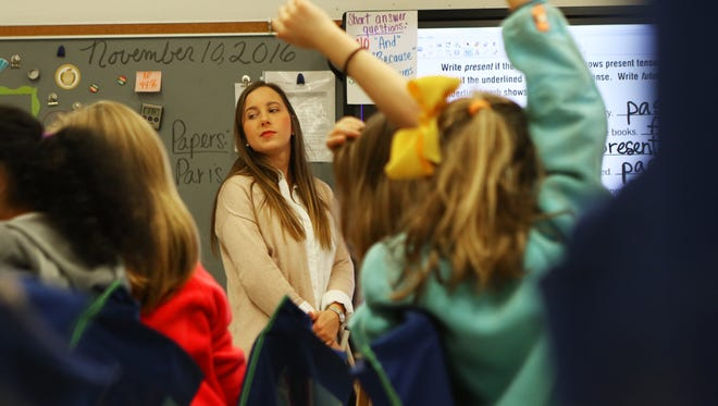 Students raise their hands as Adriane Meggs, a teaching resident at Sallie Humble Elementary and senior in Louisiana Tech's College of Education, teaches third grade English Language Arts on Thursday, Nov. 10, 2016.