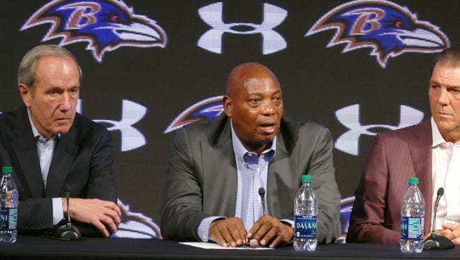 Baltimore Ravens general manager Ozzie Newsome, center, speaks as team president Dick Cass, left, and owner Steve Bisciotti listen during an NFL football news conference, Tuesday, Jan. 10, 2017, in Owings Mills, Md.