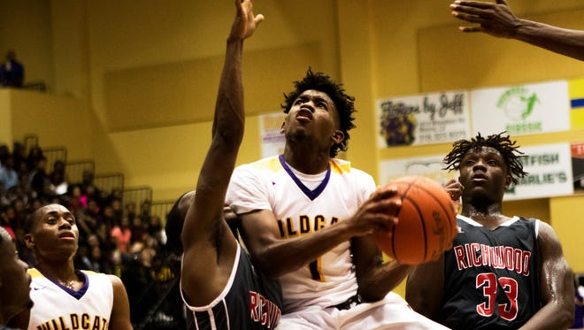Wossman guard CJ Jones jumps to make a basket as Richwood attempts to block him during the Wildcats' home game against the Rams on Tuesday, January 31, 2017.