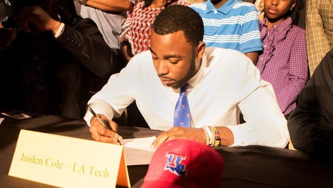 Louisiana Tech recruit Jaiden Cole signs paperwork showing his commitment to play for the Bulldogs during National Signing Day on Wednesday, February 1, 2017.