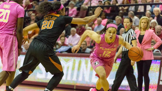 Brittany Brown (12) drives past a defender as the FSU women's basketball team falls to Texas in a 2OT thriller by a score of 92-88 on Feb. 13th.