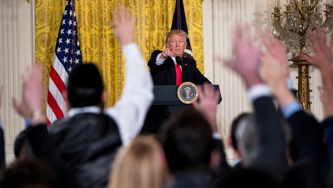 President Donald Trump calls on members of the press during a news conference, Thursday, Feb. 16, 2017, in the East Room of the White House in Washington.